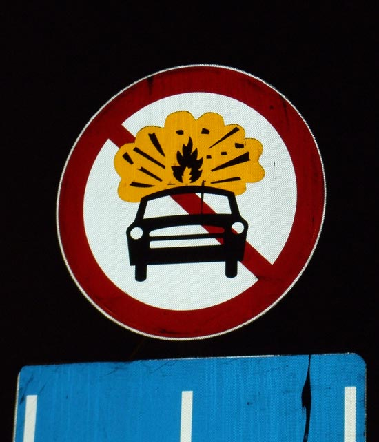 Weird sign telling people not to shoot flames out of car?