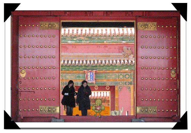 Kiweenie studies his map while going through huge doors in the Forbidden City