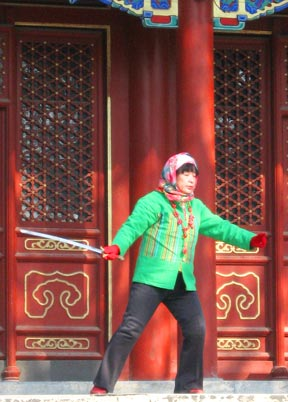 woman in Jinshan Park does sword tai-chi.